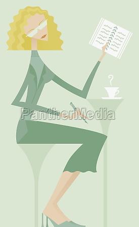 businesswoman reading a spiral notebook