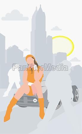 woman sitting on a car