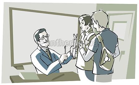 teacher teaching two students
