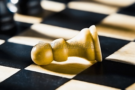 closeup of a fallen pawn on