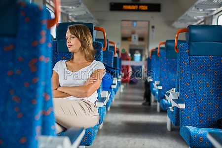 young woman sitting in the train