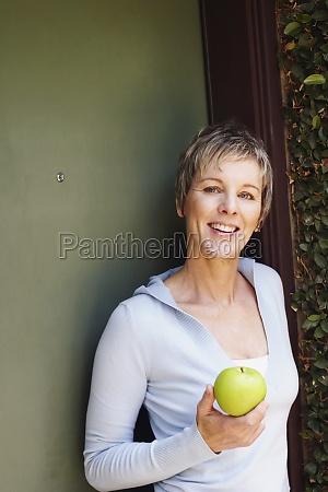 portrait of a mature woman holding