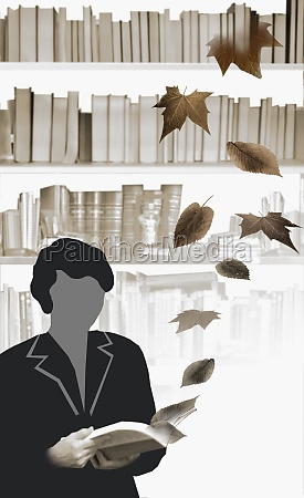 woman holding an open book with
