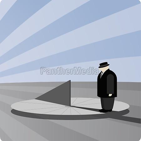 businessman standing on a sundial