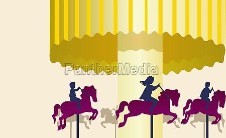 three people riding on carousel horses