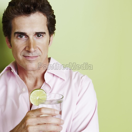 portrait of a mature man holding