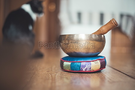 tibetan singing bowl on a rustic