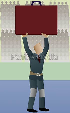 businessman holding up a briefcase in