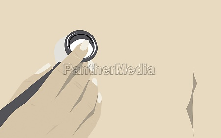 hand holding a stethoscope on a