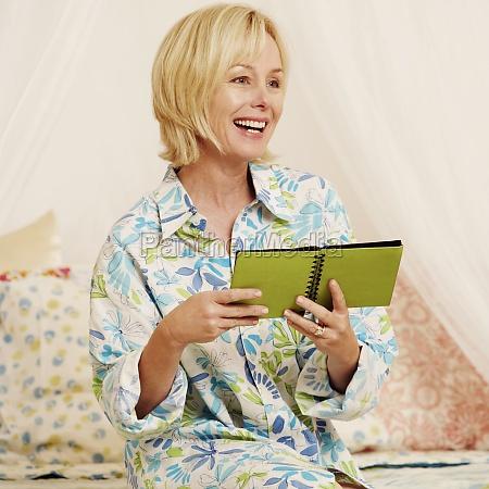 mature woman holding a photo album