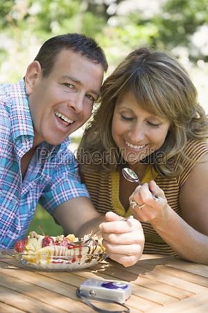 mature couple eating ice cream sundae