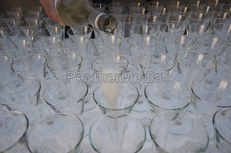 pouring champagne into champagne glasses