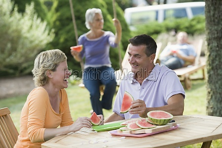 mature couple eating watermelon slices