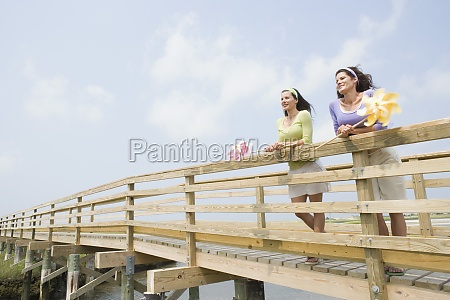 two mature women standing on a