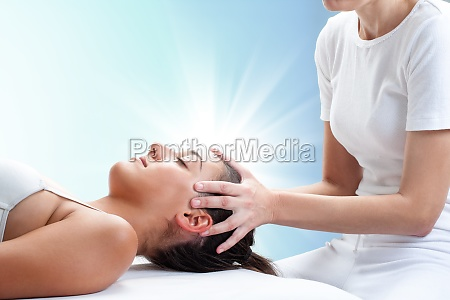 conceptual osteopathic healing with light glow