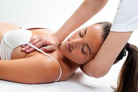 woman having osteopathic neck massage