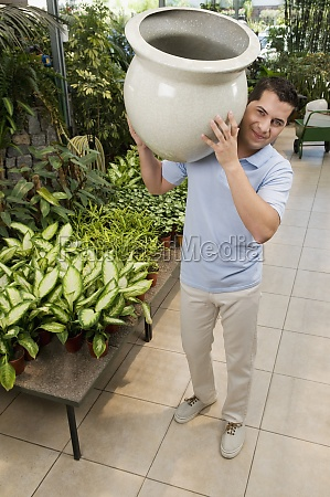 customer holding a decorative urn in