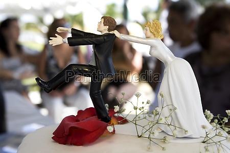 closeup of bride and groom figurines