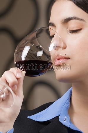 businesswoman drinking wine