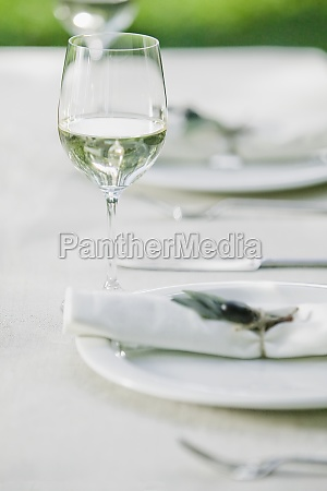 wine glasses with plates on a