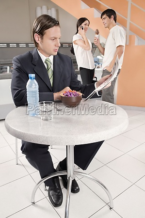 businessman reading a newspaper in an