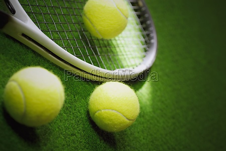 closeup of three tennis balls with