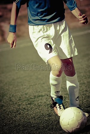 soccer player playing in a field
