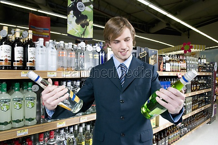 man holding wine bottles
