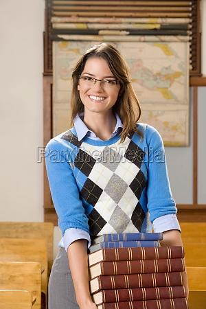 portrait of a teacher holding books