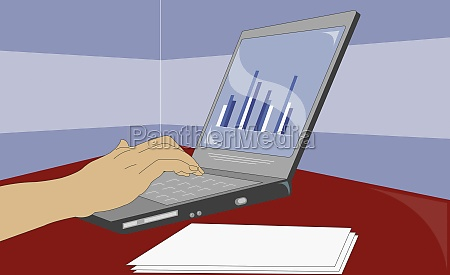 personZs hand using a laptop
