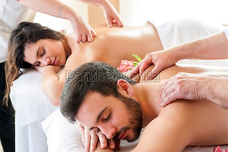 couple having relaxing body massage in