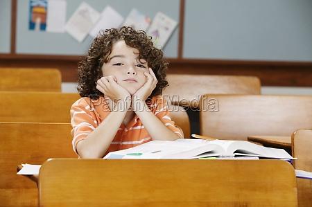 schoolboy sitting in a classroom