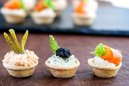 variety of savory mini pastry tartlets