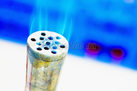 flame emerging from a metallic cylinder