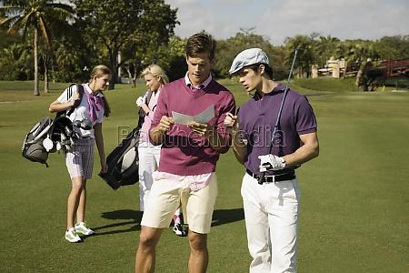 four friends discussing in a golf