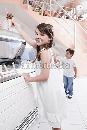 girl holding an ice cream