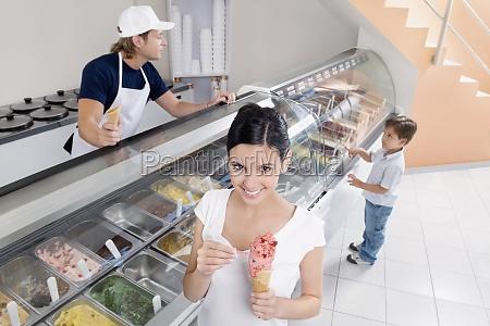 teenage girl holding an ice cream