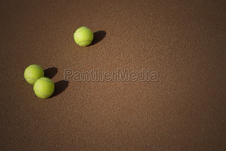 high angle view of three tennis