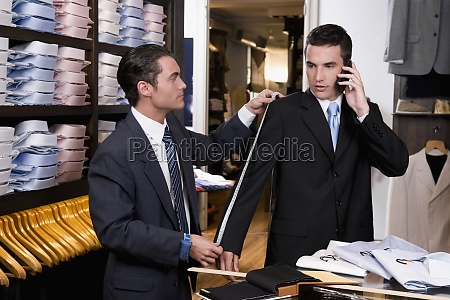tailor taking the measurements of a