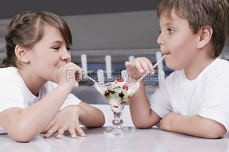 boy and a girl sharing ice