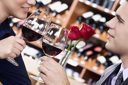 couple toasting with wine in a
