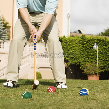 man playing croquet in a hotel