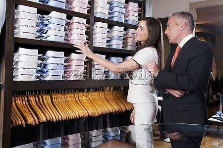 saleswoman assisting a businessman in a