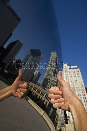 reflection of thumbs up sign on