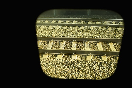 railroad track viewed through a train