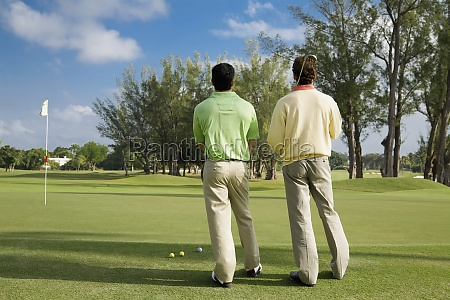 two golfer standing in a golf