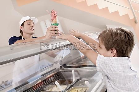 sales clerk giving ice cream to