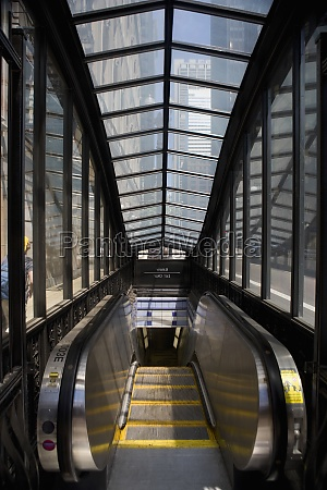 escalator in a subway station the