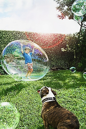 boy playing with a plastic hoop