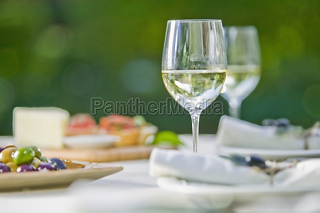 wine glass with olives on a